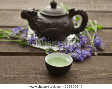 Lavender tea in a bowl on a wooden table - stock photo