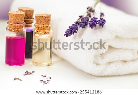 Lavender, towel and oil for massage on white background  - stock photo