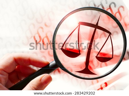 law and order, hand with magnifying lens - scale sign - stock photo