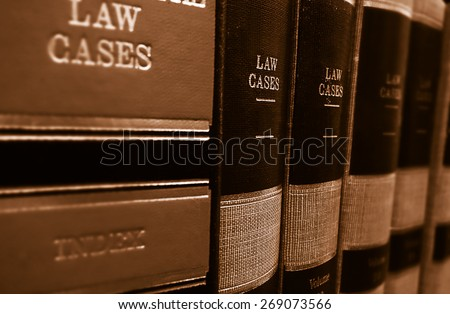 Law cases and law books on a shelf                                - stock photo