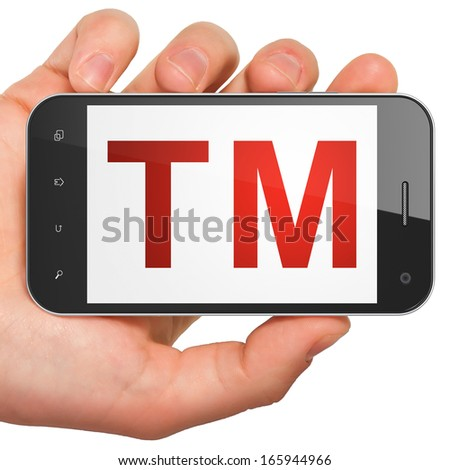Law concept: hand holding smartphone with Trademark on display. Mobile smart phone on White background, 3d render - stock photo
