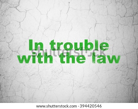 Law concept: In trouble With The law on wall background
