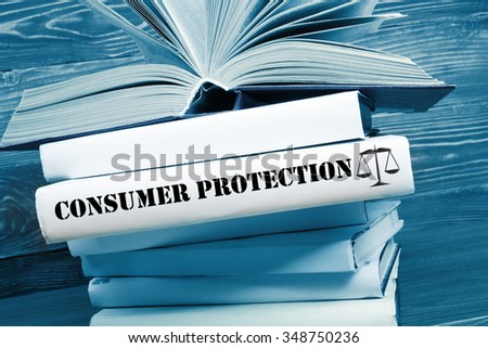 Law concept - Law book with Consumer Protection word on table in a courtroom or law enforcement office. Toned image - stock photo