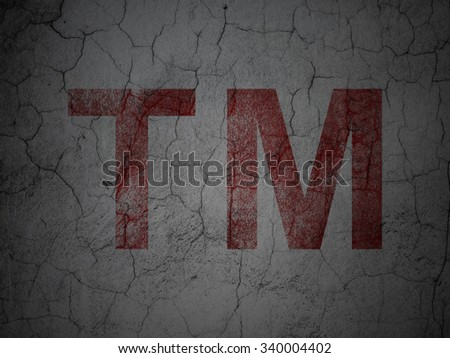 Law concept: Red Trademark on grunge textured concrete wall background - stock photo