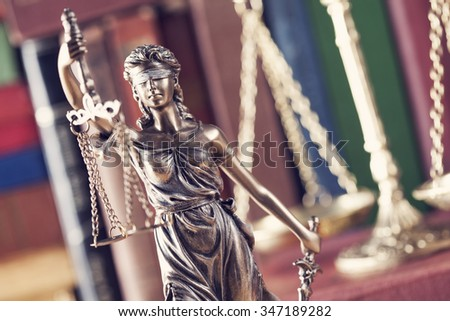 Law concept, statue, scale and books - stock photo