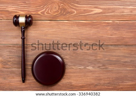 Law concept - Wooden judges gavel on table in a courtroom or law enforcement office. Top view. Copy space for text - stock photo
