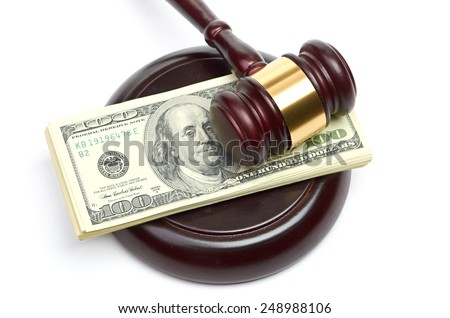 Law gavel on a stack of American money - stock photo