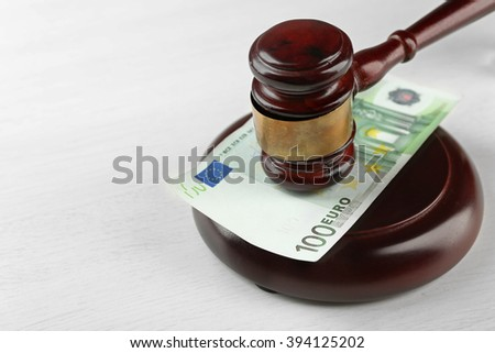 Law gavel with euro isolated on white - stock photo