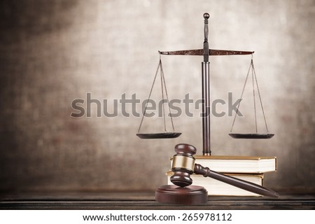 Law. Golden scales of justice, gavel and books isolated on white - stock photo