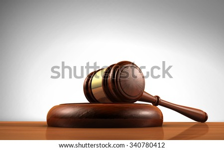 Law, justice and legal system concept with a wooden gavel judge symbol on a desktop.