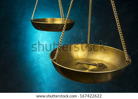 Law Justice Scale with key - stock photo