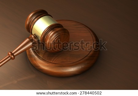 Law, lawyer and justice concept with a close-up 3d rendering of a gavel on a wooden brown desktop for banner and law firm background. - stock photo