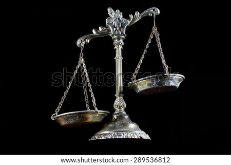 Law scales isolated on black background. Symbol of justice - stock photo