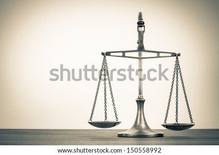Law scales on table. Symbol of justice. Vintage sepia photo - stock photo