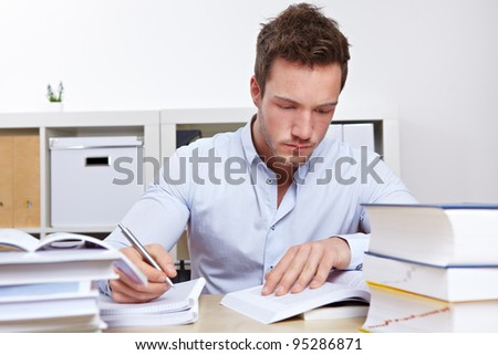 Law student with mandy books learning for university exams - stock photo