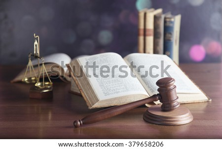 Law theme, mallet of judge, wooden gavel, books - stock photo