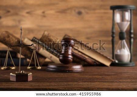 law theme, scales of justice, books, mallet of the judge, hourglass - stock photo
