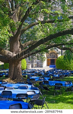 Lawn in front of White-Gravenor Hall with tables and chairs during Georgetown University reunion. Tables and chairs on a lawn under old tree. - stock photo