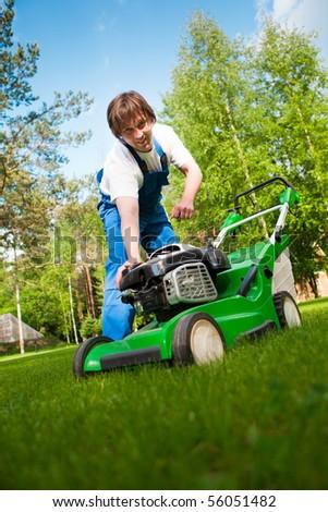 lawn mower man start up the engine - stock photo