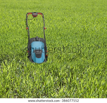 Lawn mower surrounded by high grass. - stock photo