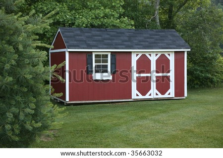 Lawn Storage Shed In A Well Landscaped Setting.