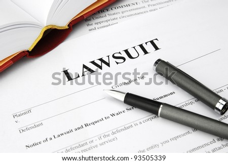 lawsuit form with filler and book - stock photo