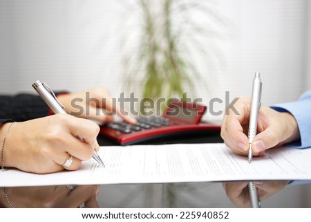 lawyer and client completing contract and prices - stock photo