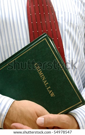 lawyer holding criminal law book , law concept , justice concept - stock photo