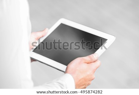 Lawyer  holding tablet on the street