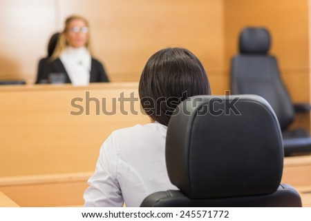 Lawyer listening to the judge in the court room - stock photo