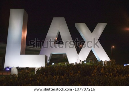 LAX sign at night welcoming travelers to Los Angeles International Airport, Los Angeles, CA - stock photo