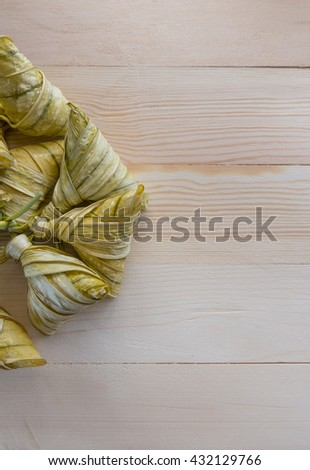 Lay flat traditional Malay cuisine called 'ketupat' made from glutinous rice. - stock photo