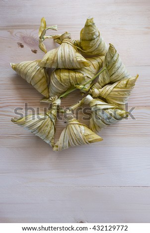 Lay flat traditional Malay cuisine called 'ketupat' made from glutinous rice.