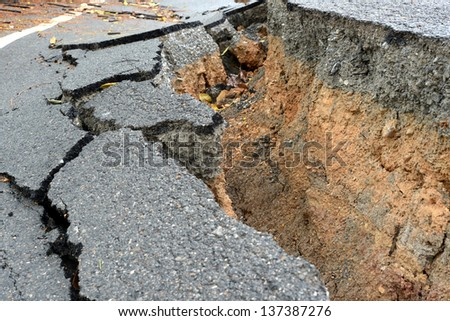 layer of broken asphalt road at rural areas. - stock photo
