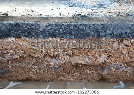 Layer soil beneath asphalt cement concrete - stock photo
