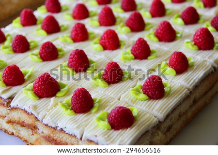Layered cake with raspberries on top  - stock photo