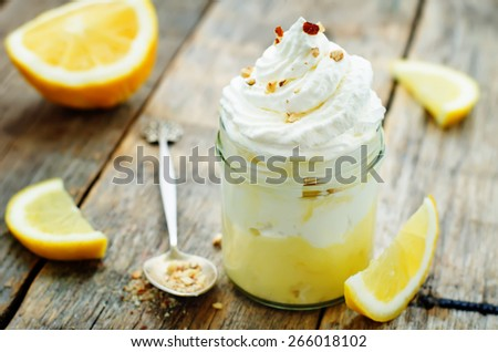 layered dessert with lemon cream, ice cream and whipped cream. tinting. selective focus - stock photo