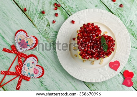 Layered salad from vegetables on the holiday table. Salad with walnuts, cheese, pomegranate and vegetables. Wedding day. Valentine's day. Top view - stock photo