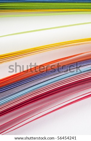 layers of coloured paper - stock photo