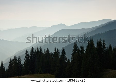 Layers of mountain and haze in the valleys