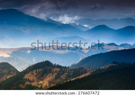 Layers of mountain and haze in the valleys. - stock photo