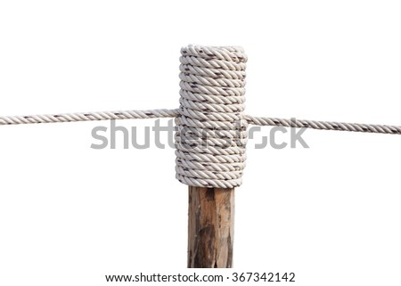 Layers of rope tied around a wooden log