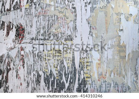 Layers of torn paper peeled posters abstract grunge background texture. - stock photo