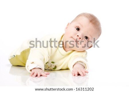 Laying baby happy - face expression - stock photo