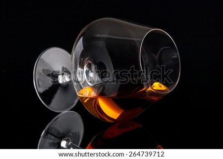 Laying brandy glass - stock photo