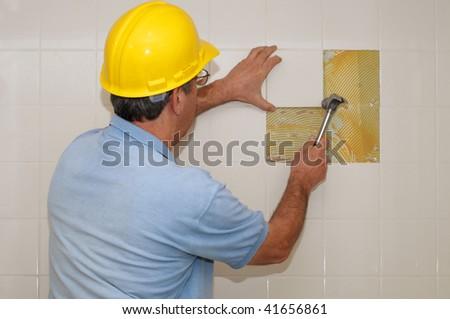 Laying ceramic tiles - stock photo