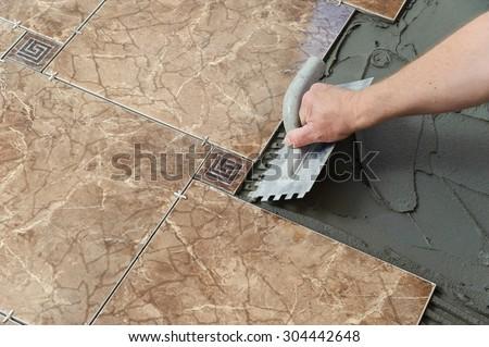Laying Ceramic Tiles Troweling Adhesive Onto Stock Photo Royalty