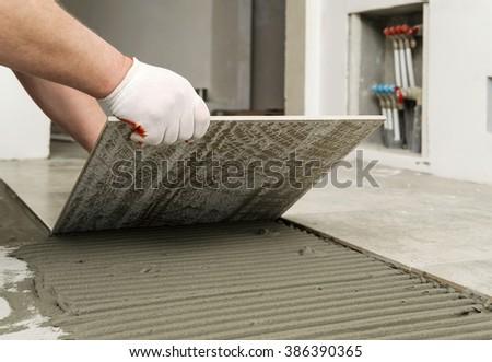 Laying Ceramic Tiles Worker Placing Ceramic Stock Photo Royalty