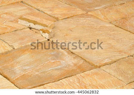 Laying concrete outdoor tiles, sandstone colored paving on the terrace - stock photo