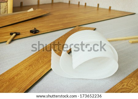 Laying indoors laminated panels the color of the wood - stock photo